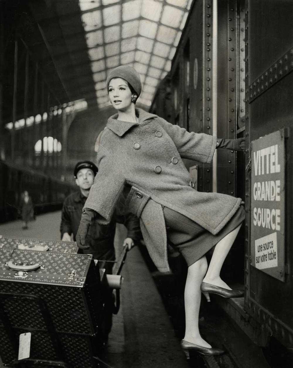 © Estate of Louis Faurer, Model hanging out of Train Car, Paris, 1960