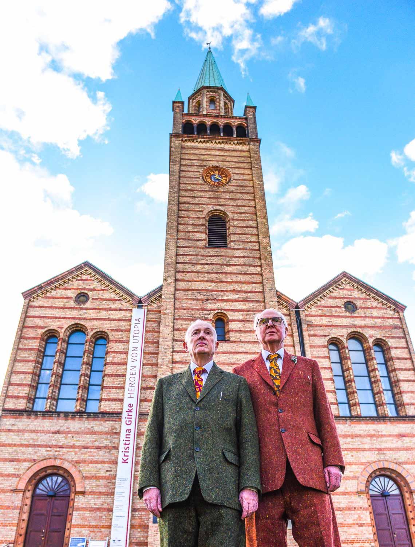 Gilbert & George in front of the St. Matthew Church Berlin. Photo: Daniel Biskup.