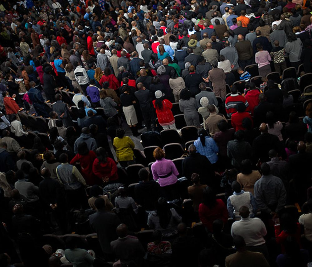 Some of the 25,000 members of Pastor Eddie Long's New Birth Baptist Church in Atlanta, USA. Long, who has received millions from the church in salary, preaches that homosexuality is a sin and that God rewards believers with riches. 2010 Nina Berman - NOOR