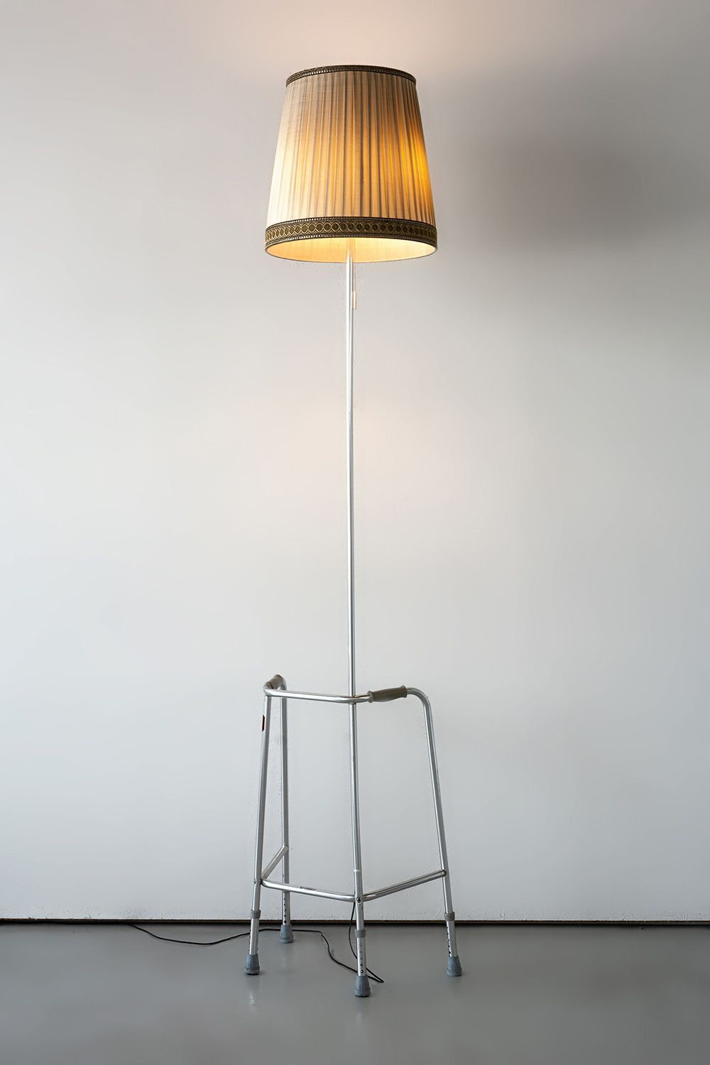 Always Stand On The Bright Side Of Life, 2019 Steel walker, pipe extension, lamp shade, light bulbs
